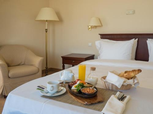Кровать или кровати в номере Рэдиссон Славянская Отель и Бизнес Центр