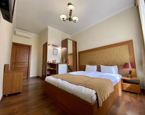 מיטה או מיטות בחדר ב-Boomerang Business Hotel