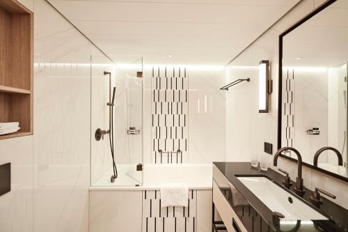 A bathroom at Storchen Zürich - Lifestyle boutique Hotel