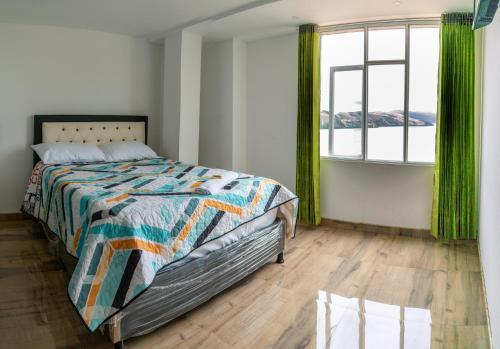 A bed or beds in a room at Playa Blanca - El Mana