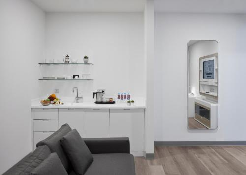 A kitchen or kitchenette at YOTELAIR Istanbul Airport, Duty free - International Transit area