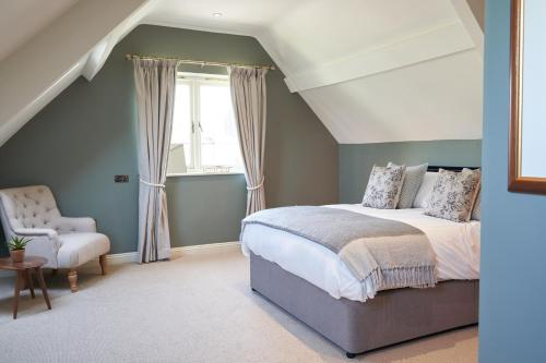 A bed or beds in a room at Beckford Inn