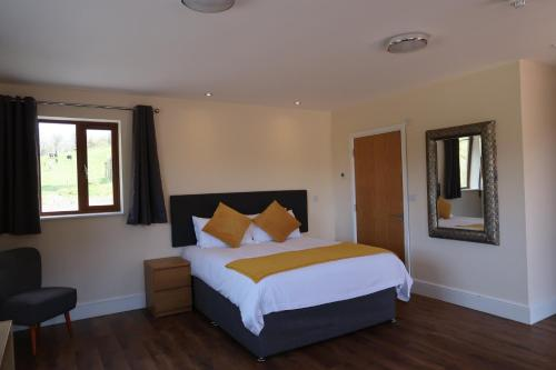 A bed or beds in a room at Lillypool Farm
