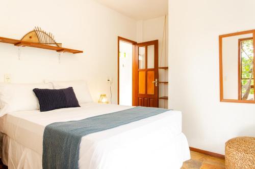 Cama ou camas em um quarto em Jeri Pousada