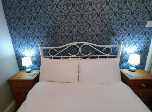 A bed or beds in a room at Branstone Guest House