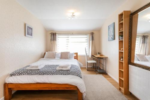 A bed or beds in a room at Grange Hömli
