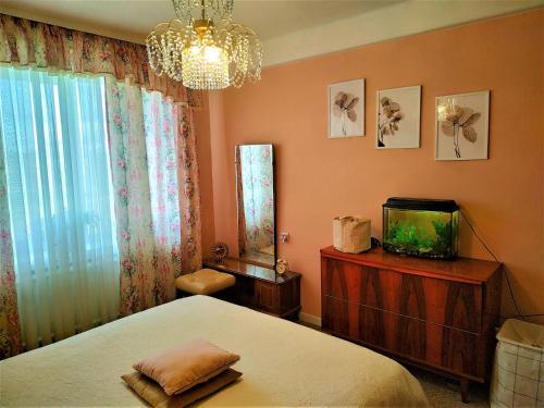 Кровать или кровати в номере Apartment on Prospekt Marshala Blyukhera