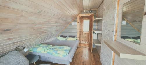 Voodi või voodid majutusasutuse Partsilombi Holiday Home toas