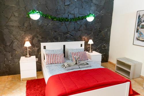 A bed or beds in a room at Dream Lagos B&B