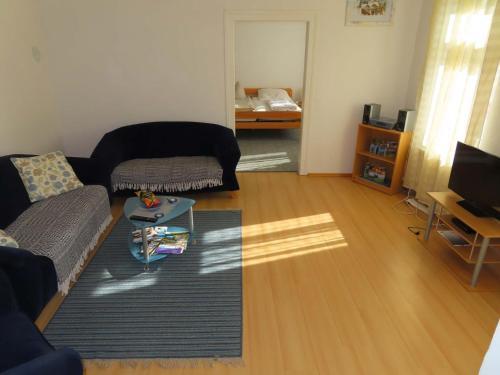 Ein Sitzbereich in der Unterkunft Ferienwohnungen am Weinberg Bad Sulza