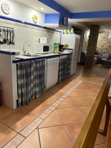 A kitchen or kitchenette at Apartamento bodega intima