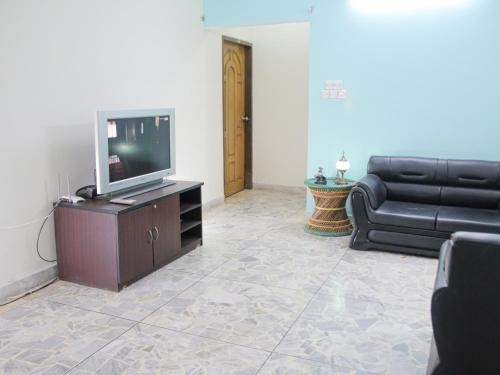 A television and/or entertainment center at Golpata Bed & Breakfast