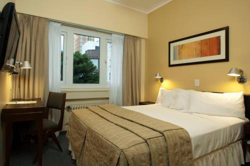 Кровать или кровати в номере Austral Express