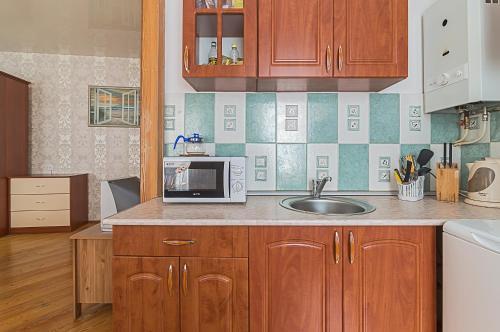 Кухня или мини-кухня в Апартаменты на ул. Казанская, д. 9