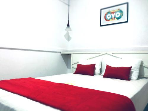 A bed or beds in a room at Morada Do Sol Hotel