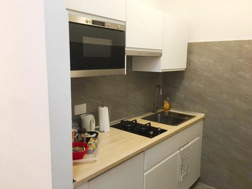 A kitchen or kitchenette at Affittacamere Delfo