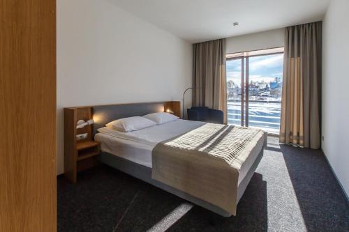 Кровать или кровати в номере ГТК Суздаль
