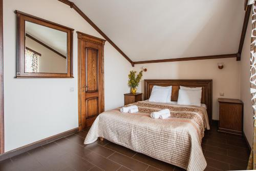 Кровать или кровати в номере Гостевой дом Христофор