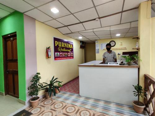 The lobby or reception area at Purnima Residency