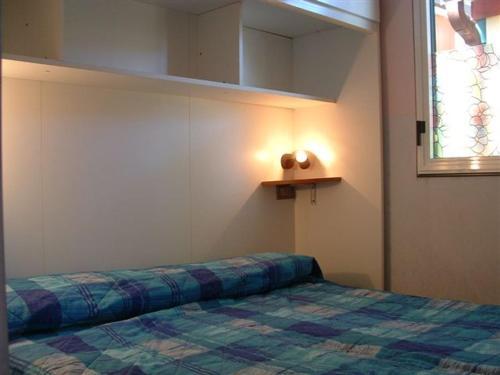 Letto o letti in una camera di Camping village Internazionale