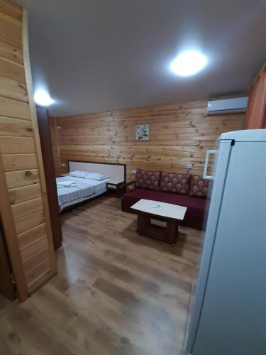 A bed or beds in a room at Южный дворик