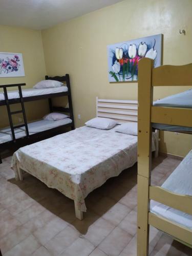 A bunk bed or bunk beds in a room at Pousada Sol de Iracema Centro