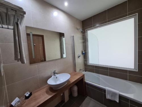 A bathroom at Water's Edge Hotel