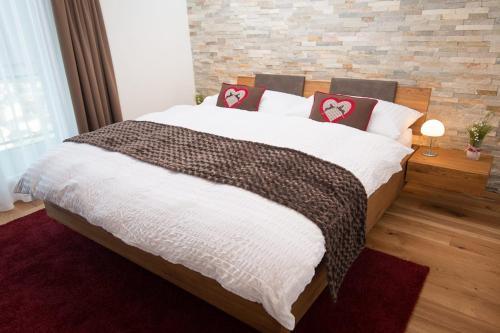 Ein Bett oder Betten in einem Zimmer der Unterkunft Hotel Roggerli