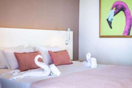 Cama ou camas em um quarto em Coral Estate Luxury Resort
