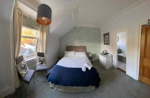 A bed or beds in a room at The Colintraive