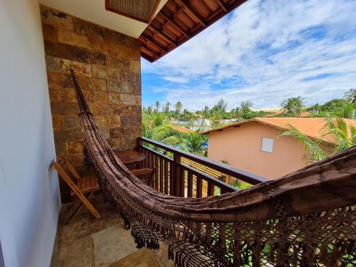 A balcony or terrace at Pousada Bosque Cumbuco