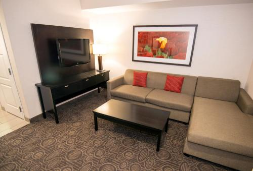 A television and/or entertainment center at Holiday Inn Hotel & Suites Red Deer, an IHG Hotel