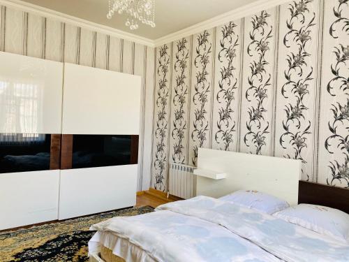 Cama ou camas em um quarto em House in Quba