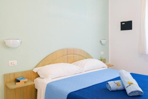 A bed or beds in a room at Residence PendraSardinia Costa del Turchese by PendraHolidays