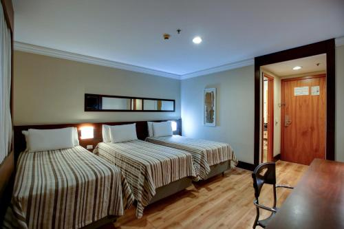 A bed or beds in a room at Transamerica Executive Congonhas