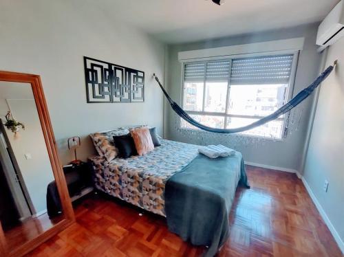 A bed or beds in a room at Loft Contemporâneo Centro de São Leopoldo com Wi-Fi