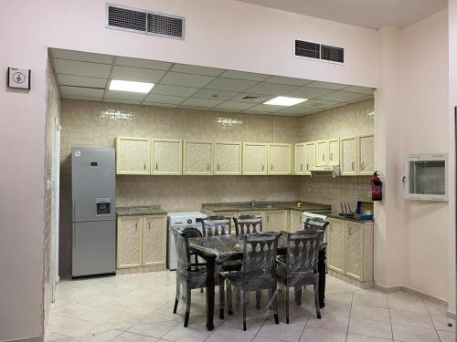 A kitchen or kitchenette at Dubai bed space and private room