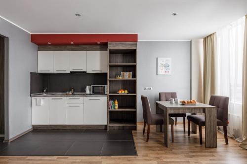 Кухня или мини-кухня в Апарт-отель Вертикаль