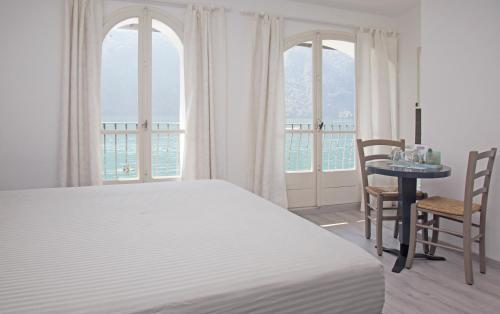 Letto o letti in una camera di Locanda Gandriese
