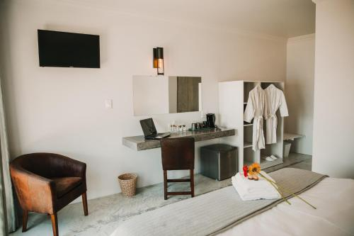 A television and/or entertainment center at Giardino Boutique Hotel