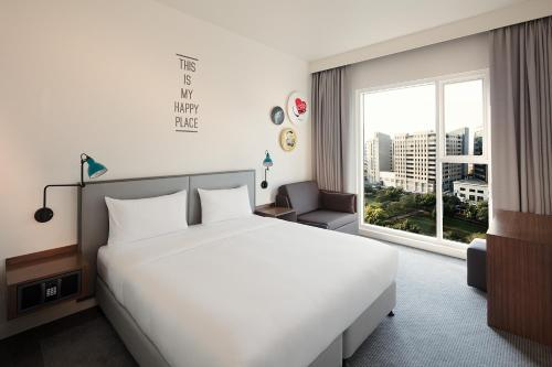 A bed or beds in a room at Rove City Centre