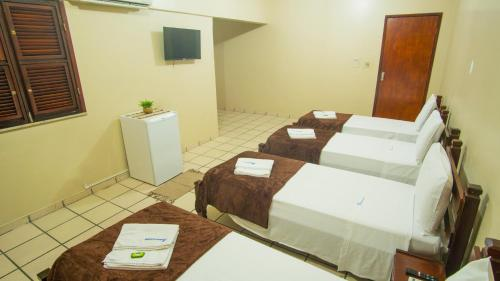 A bed or beds in a room at Nordeste Palace Hotel