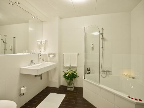 Een badkamer bij Hotel Chariot