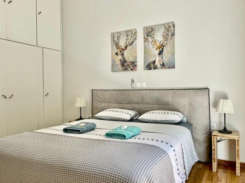 A bed or beds in a room at Five Brand New Boutique Apartments Central Athens
