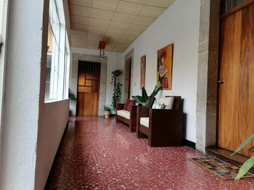 The lobby or reception area at Hotel Muchá