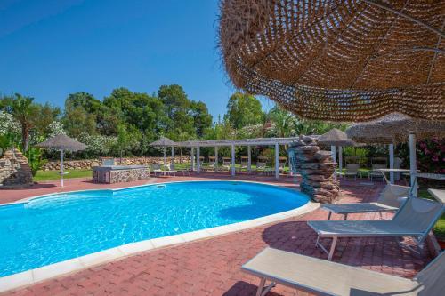 The swimming pool at or near Hotel Rurale Orti di Nora & SPA