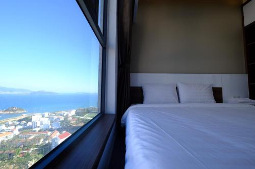 A bed or beds in a room at Stay in Nha Trang Apartment