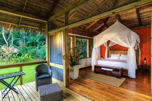 A bed or beds in a room at Pacuare Lodge