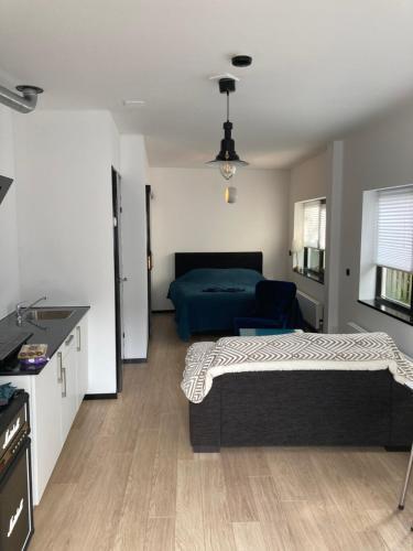 Een bed of bedden in een kamer bij Sheepyhead