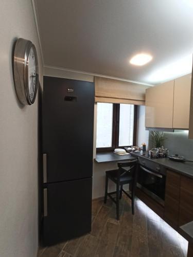 A kitchen or kitchenette at Salvador Апартаменты метро Красный проспект